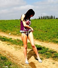 Naughty babe stains dirt road with her smelly piss