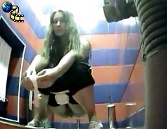 Yummy young chicks tinkle in public loo on spy cam