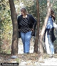 Curly mature plumper squats in the woods