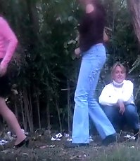 Peeing chick caught on voyeur cam among the woods